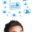 Young head looking at social type of icons and signs — Stock Photo #6859956