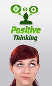 Junges mädchen blick auf positive und negative zeichen — Stockfoto