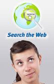 Ung tjej söker på internet typ av ikoner — Stockfoto