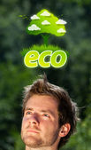 Young head looking at green eco sign — Stock Photo