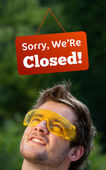 Young persons head looking at closed and open signs — Stock Photo