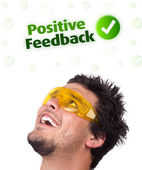 Jeune tête en regardant les signes négatifs positifs — Photo