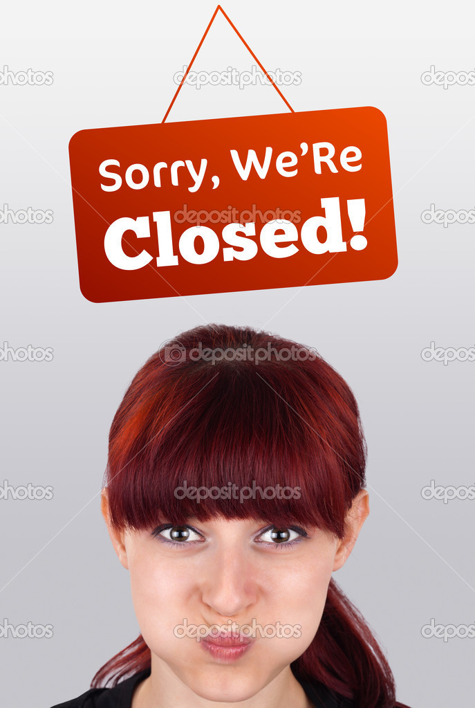 Young girl head looking at closed and open signs — Stock Photo #6854029