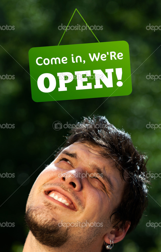 Young persons head looking at closed and open signs — Stock Photo #6855668
