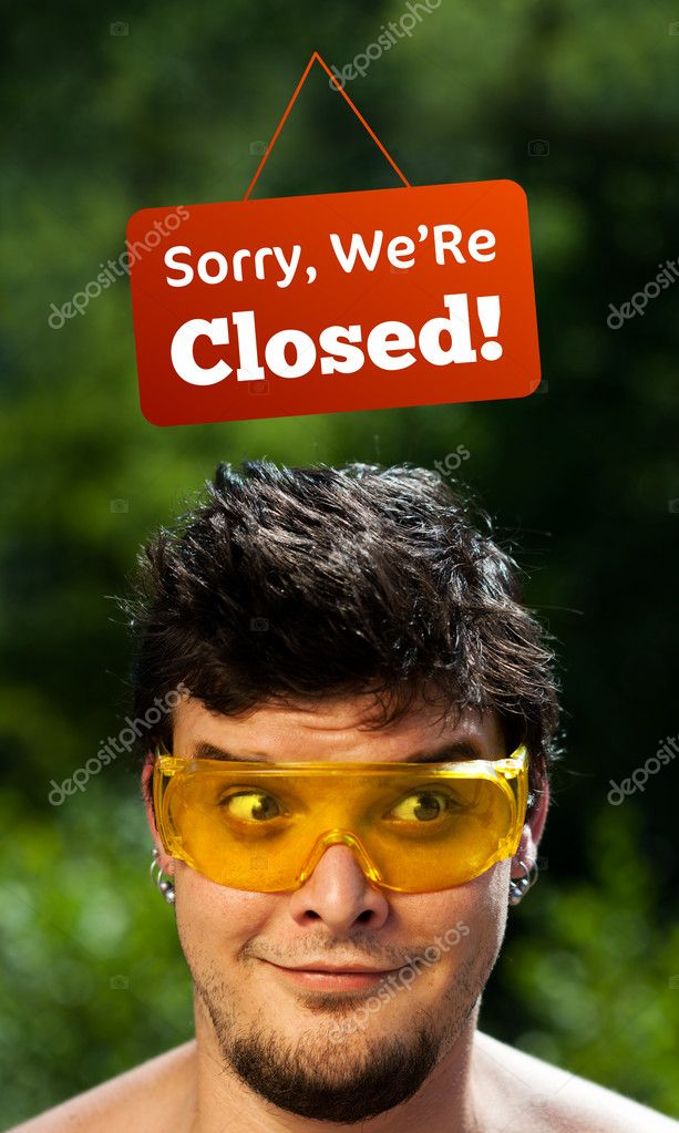 Young persons head looking at closed and open signs — Stock Photo #6855850