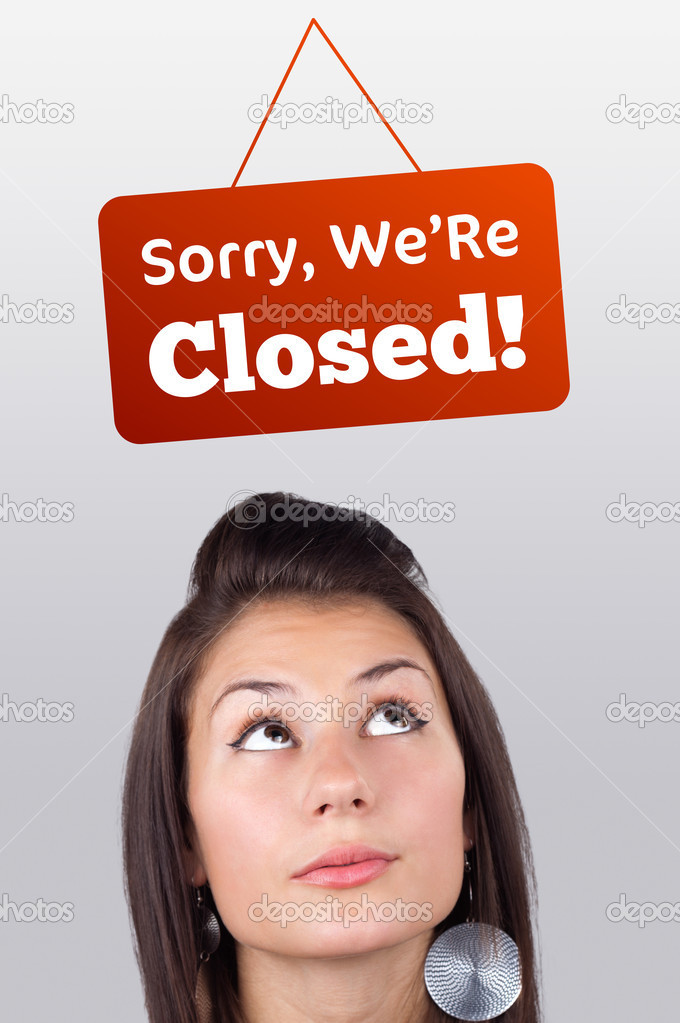 Young girl head looking at closed and open signs — Stock Photo #6856910