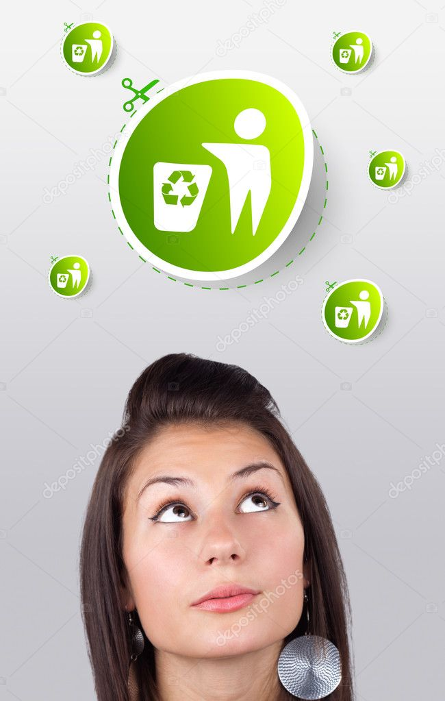 Young girl head looking at green eco sign  Stock Photo #6856971