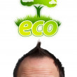Young head looking at green eco sign — Stock Photo #6860145