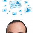 Young head looking at social type of icons and signs — Stock Photo #6860321