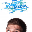 Young head looking at social type of icons and signs — Stock Photo #6860376