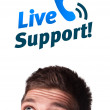Young head looking at support contact type of icons and signs — Stock Photo #6860413