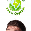 Young head looking at green eco sign — Foto de Stock