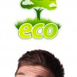 Young head looking at green eco sign — Stock Photo #6860462