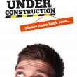 Young head looking at contruction icons — Stock Photo #6860499