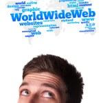 joven cabeza mirando en internet el tipo de iconos — Foto de Stock