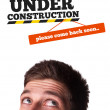 Young head looking at contruction icons — Foto Stock