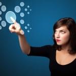 Businesswoman pressing high tech type of modern buttons — Stock Photo #6862068