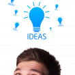 Royalty-Free Stock Photo: Young person looking at idea type of sign