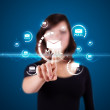 Businesswoman pressing virtual messaging type of icons — Stock Photo