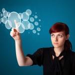 Businesswoman pressing high tech type of modern buttons — Stock Photo #6863292