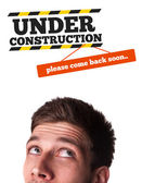Young head looking at contruction icons — Stock Photo