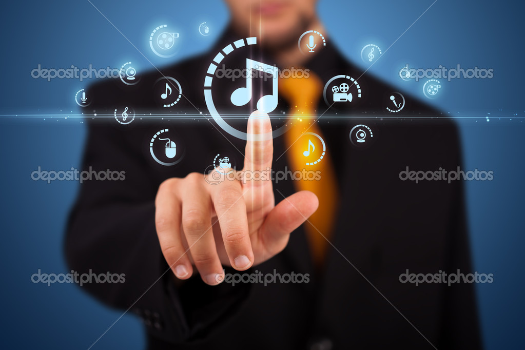 Businessman pressing multimedia type of modern buttons with virtual background — Stock Photo #6860869