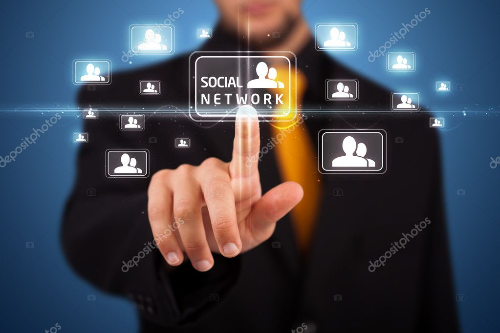 Businessman pressing modern social buttons on a virtual background  Stock Photo #6860887