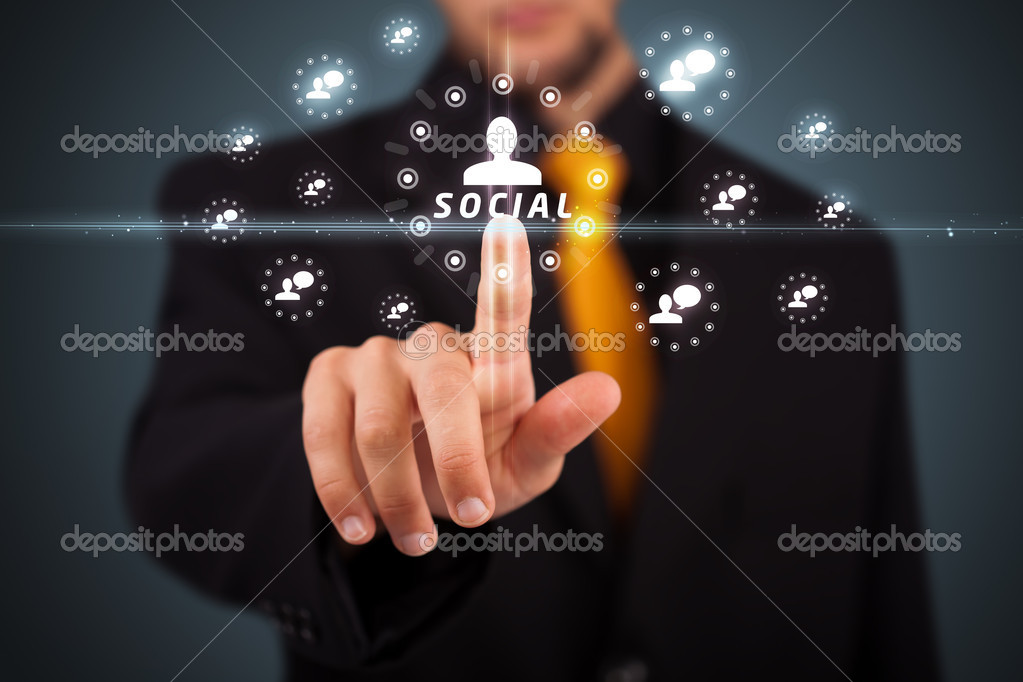 Businessman pressing modern social buttons on a virtual background — Stock Photo #6860893