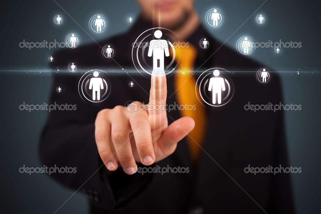 Businessman pressing modern social buttons on a virtual background — Stock Photo #6860896