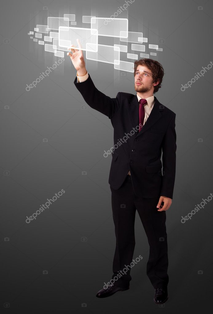 Businessman pressing high tech type of modern buttons on a virtual background — Stock Photo #6861094