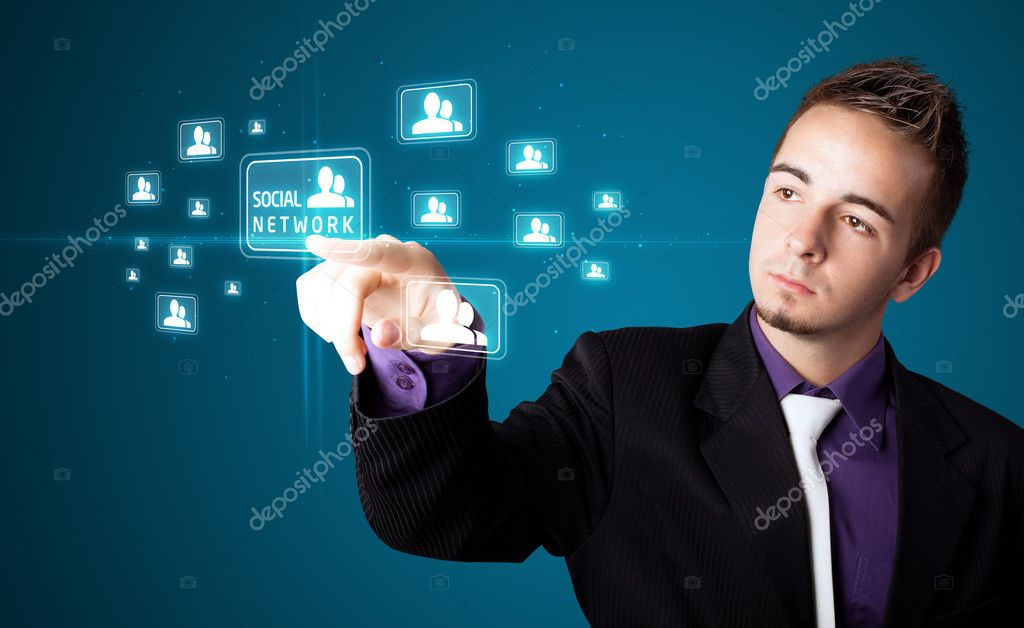 Businessman pressing modern social buttons on a virtual background — Stock Photo #6861486