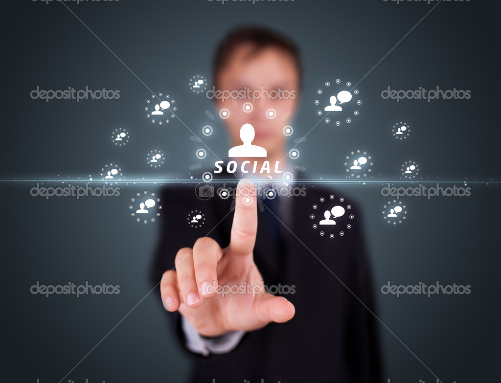 Businessman pressing modern social buttons on a virtual background  Stock Photo #6864060