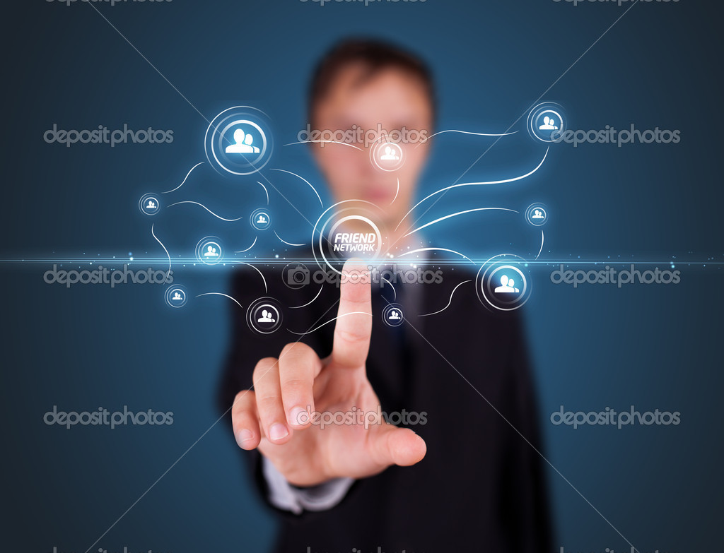 Businessman pressing modern social buttons on a virtual background — Stock Photo #6864064