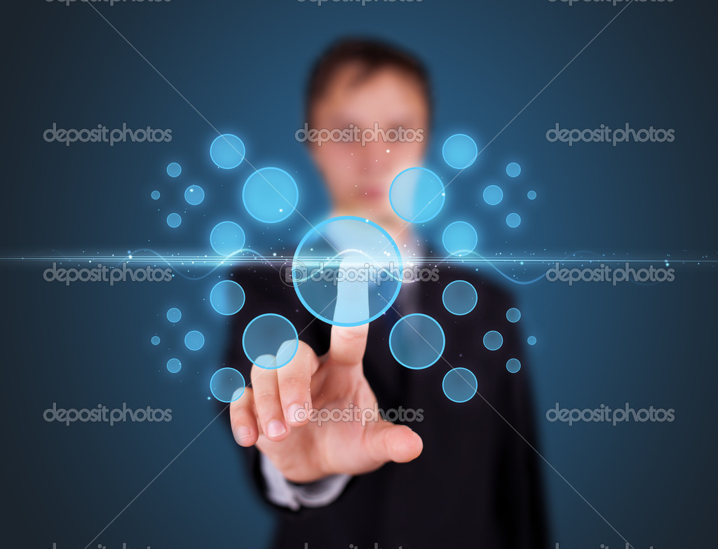 Businessman pressing high tech type of modern buttons on a virtual background — Stock Photo #6864164