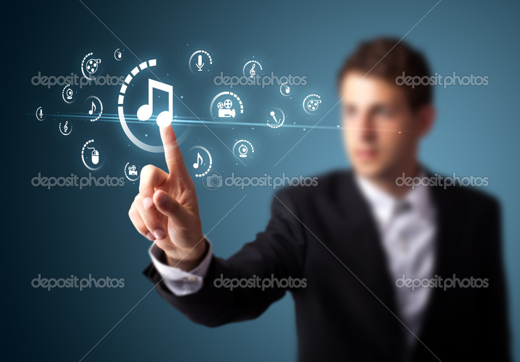 Businessman pressing multimedia type of modern buttons with virtual background — Stock Photo #6864592