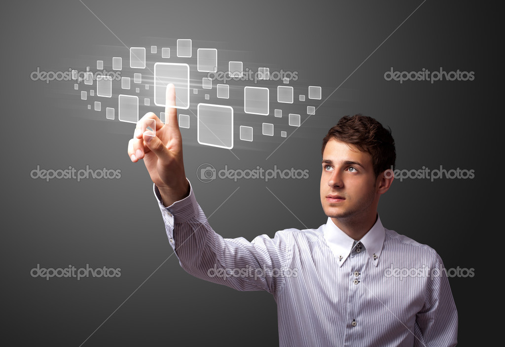 Businessman pressing high tech type of modern buttons on a virtual background  Stock Photo #6864719