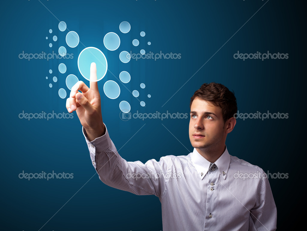 Businessman pressing high tech type of modern buttons on a virtual background — Stock Photo #6864725