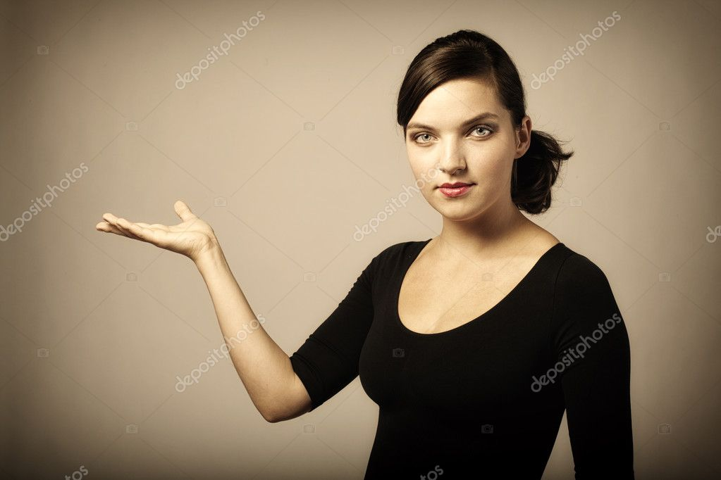 Woman presenting something imaginary with her right hand, vintage colors  — Stock Photo #7227365
