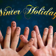 winter holidays finger group with smiley faces on green backgrou — Stock Photo
