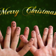 Merry christmas happy finger group with smiley faces on green ba - Stok fotoraf