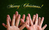 Merry christmas happy finger group with smiley faces on green ba — Stock Photo
