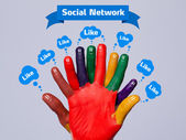 Colorful happy finger smileys with social network sign and like — Stock Photo
