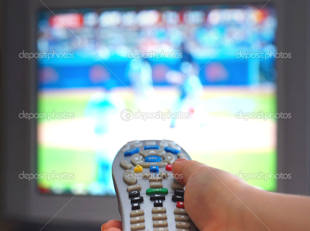 Channel surfing with remote — Stock Photo #7544213