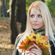 Young blond girl in the park — Stock Photo