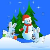 Iki beyaz tavşan ve kardan adam — Stok fotoğraf