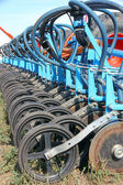 Tractor and seeder planting crops on a field — Stock Photo