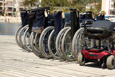 Wheelchairs at harbor waiting for passengers — Stock Photo