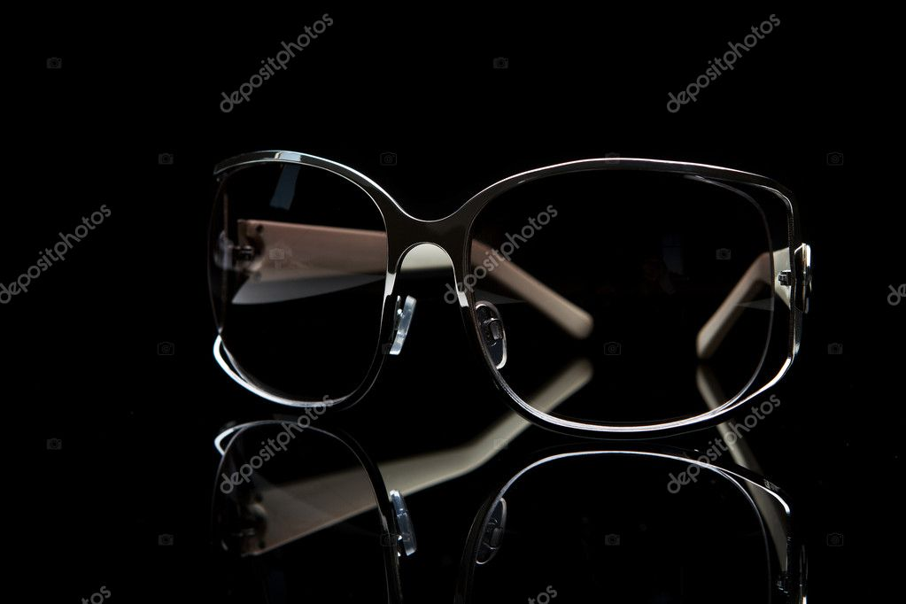Stylish silver sunglasses over black background  Stock Photo #7333198