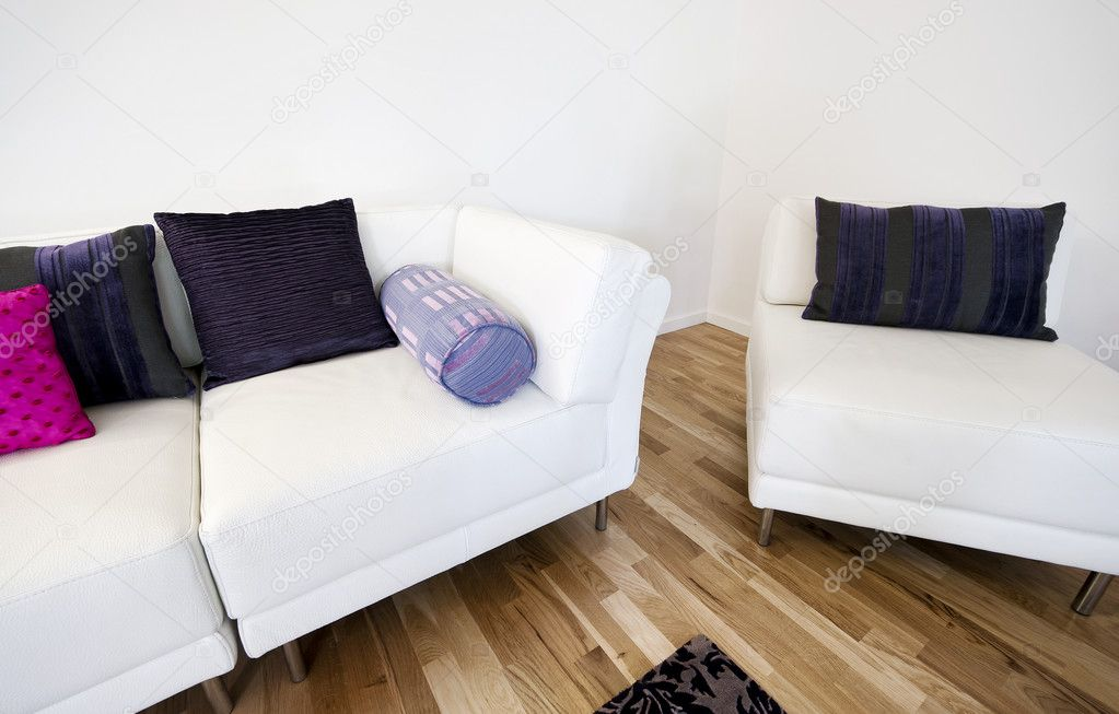Modern white leather armchar and sofa with dark cushions — Stock Photo #7491691