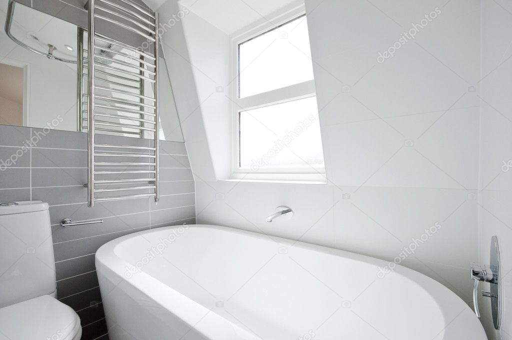 Modern loft en-suite with large oval bath and window  Stock Photo #7491835